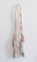 Hand dyed, coiled with tassels